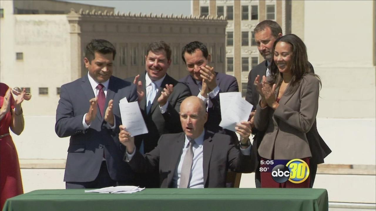 Gov Jerry Brown signs four climate change bills in downtown Fresno