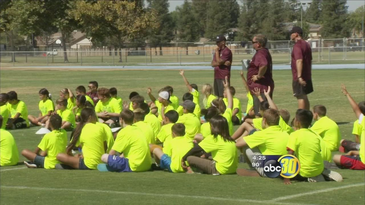 Good Sports: Garth Brooks Football Camp