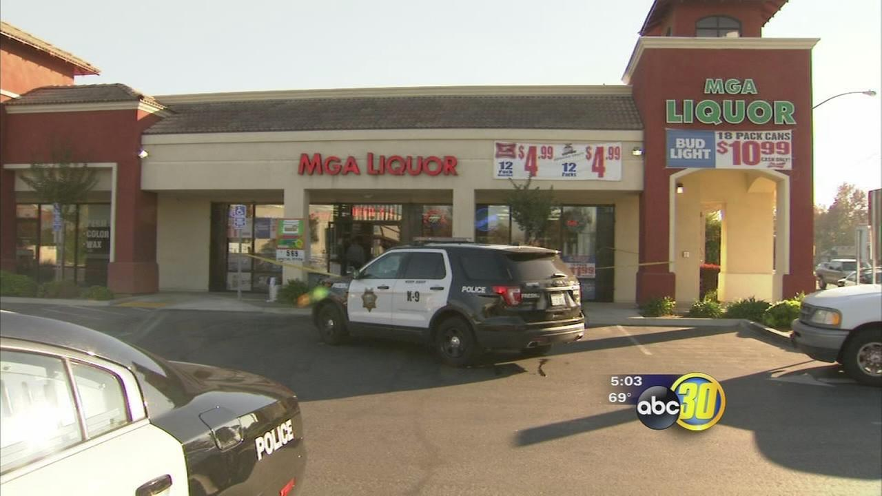 Suspects handcuff Fresno liquor store employees during armed robbery