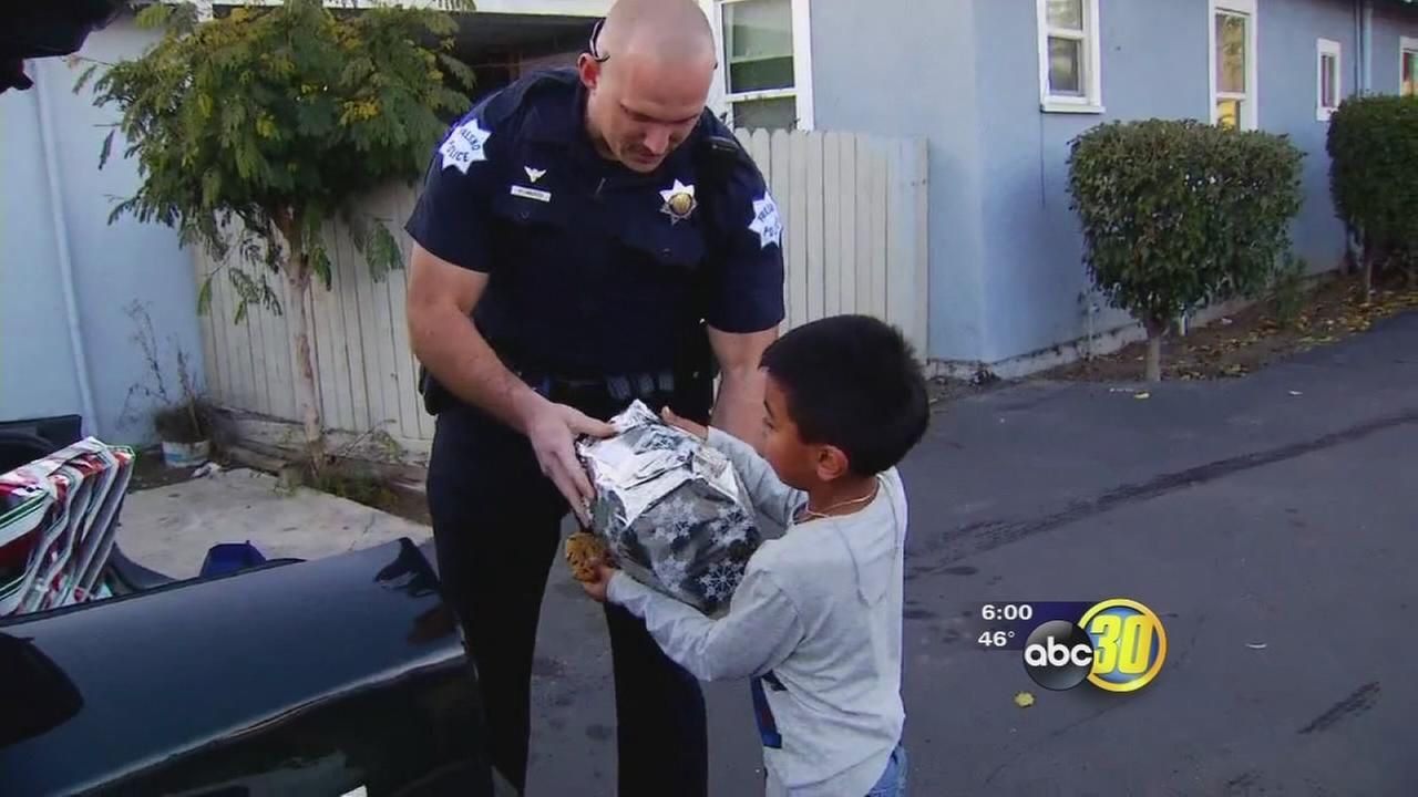 Fresno Police officers deliver hundreds of gifts to kids in need