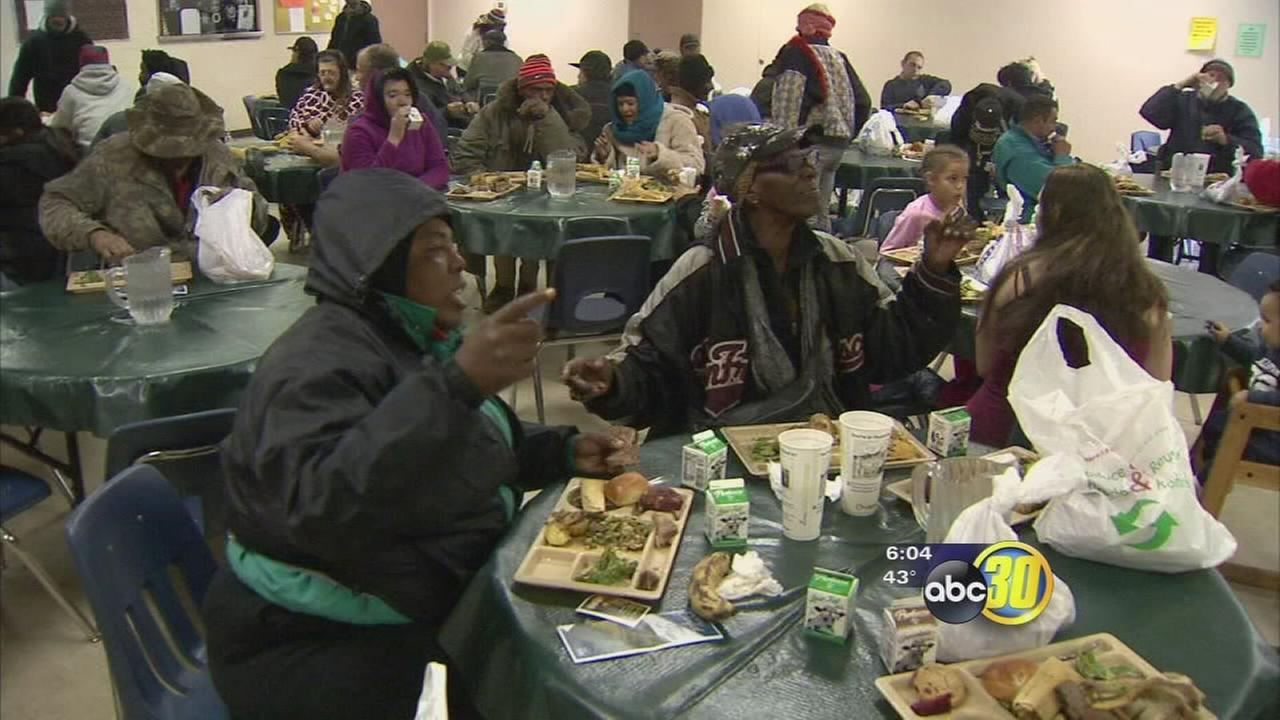 Volunteers deliver presents and serve Christmas dinner at Poverello House