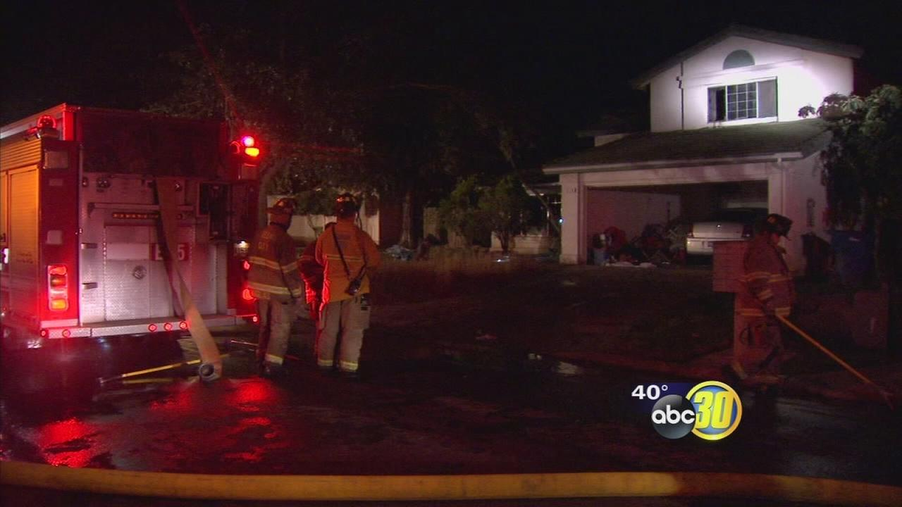 10 people trapped in burning home in Southeast Fresno escape through second story window