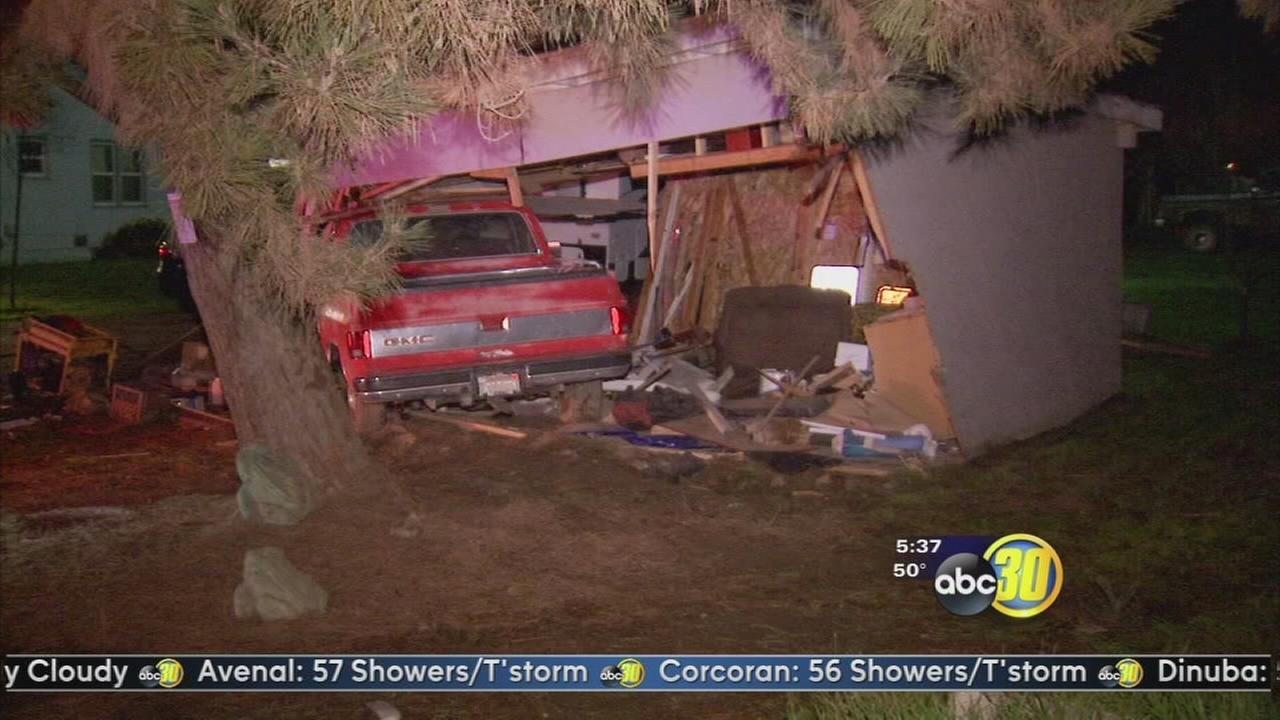 3 injured after crashing into garage near Hanford