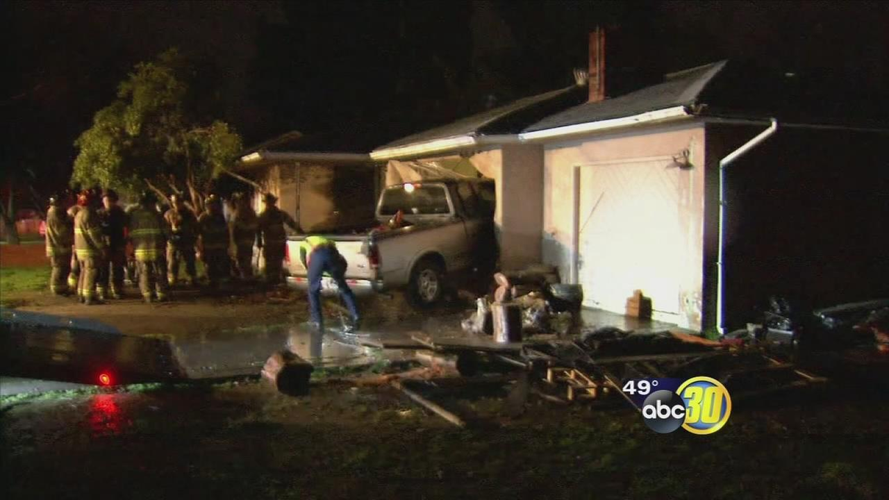Suspected drunk driver slams truck into Fresno home