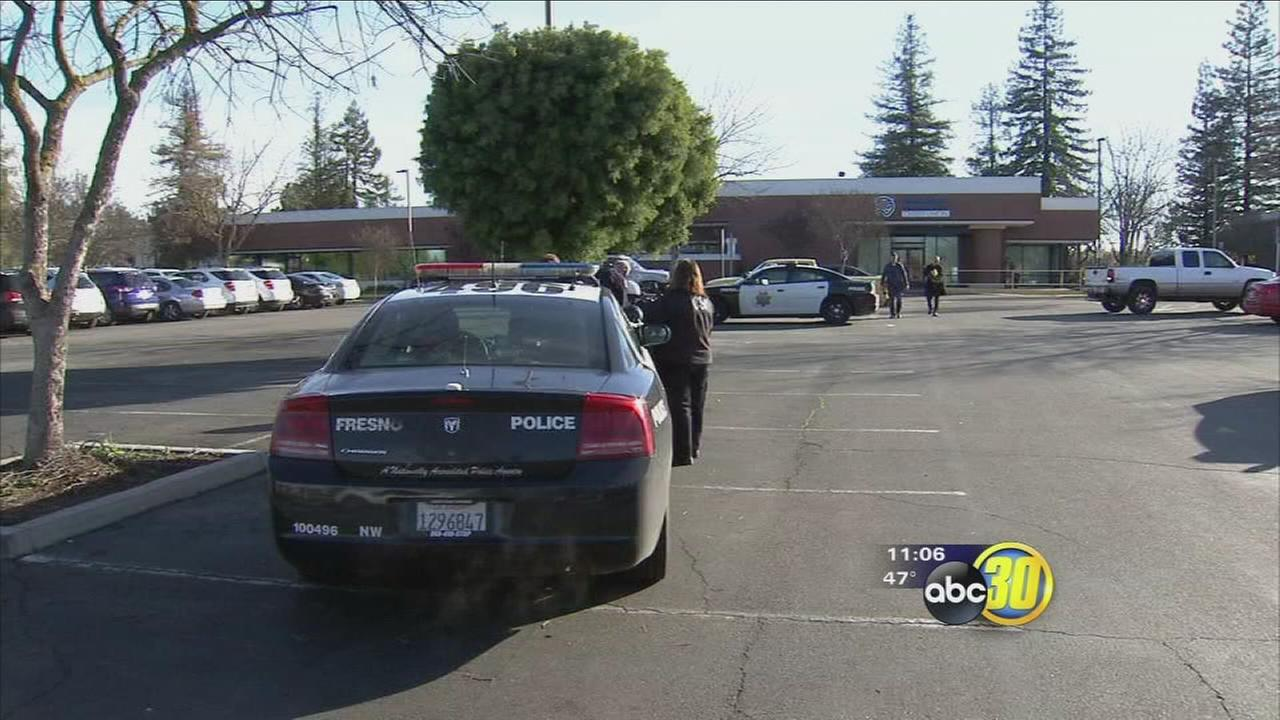 Police say suspect holds bank employee hostage during botched robbery in Northwest Fresno