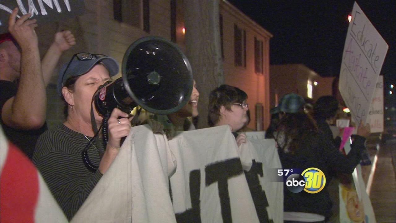 Dozens of people protest outside Congressman Devin Nunes office in Clovis