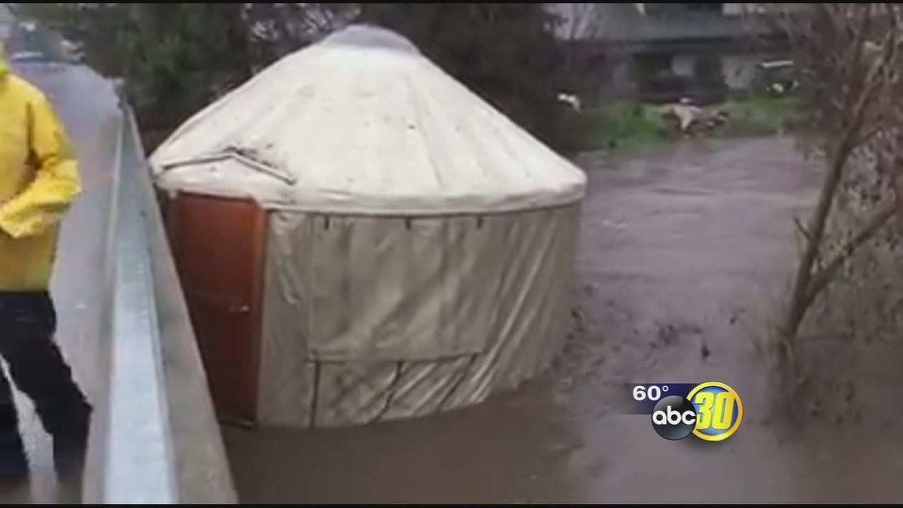2 yurts washed away by floodwaters, crash into bridge in Oakhurst