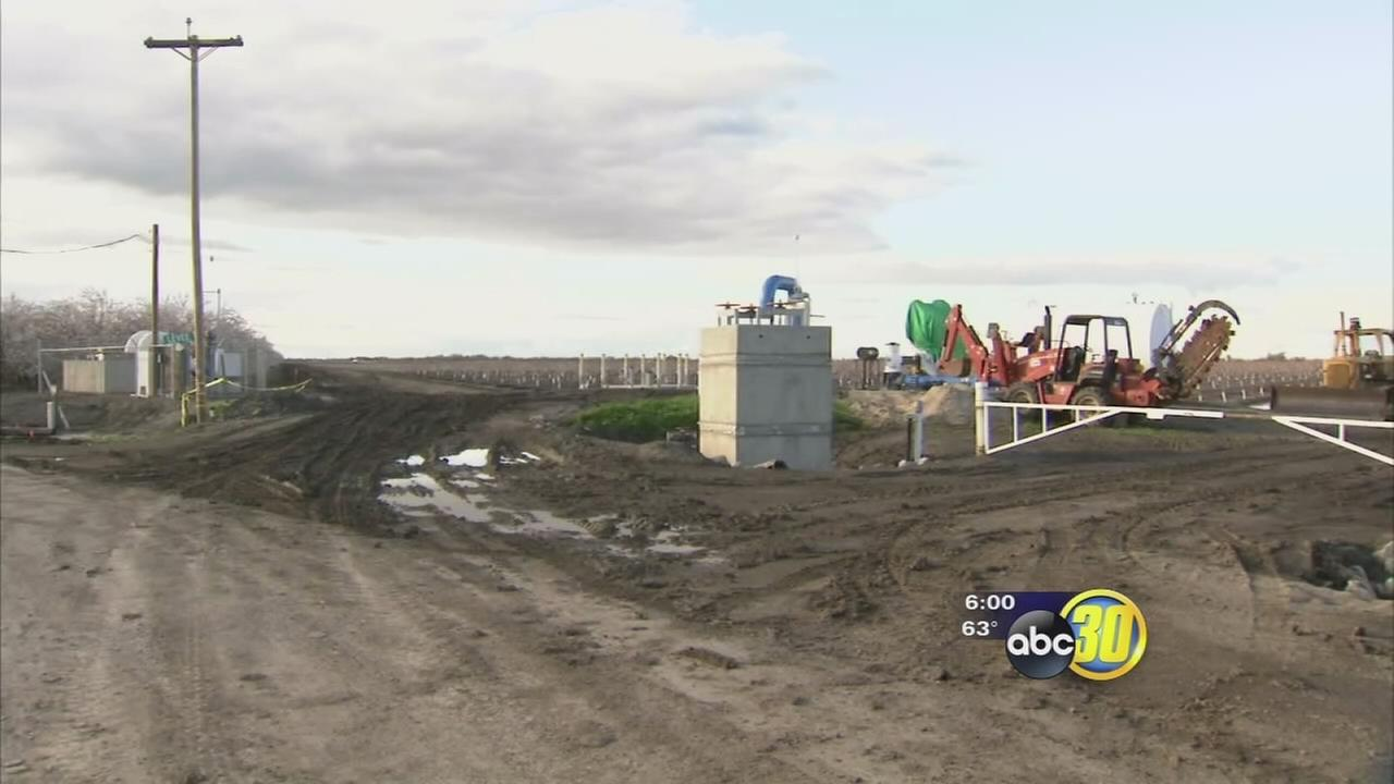 Crews scramble to repair damaged Tranquility levee before next storm