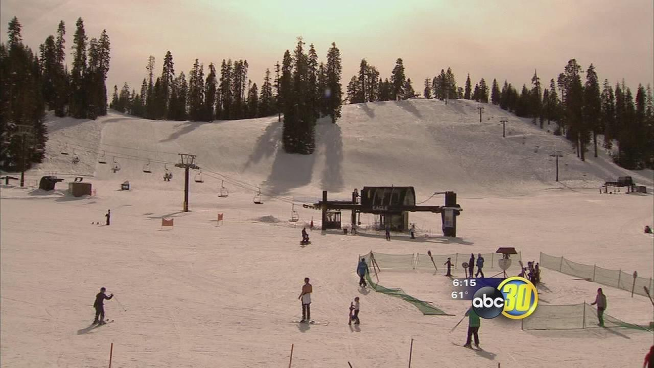 Skiers and snowboarders enjoying fresh snow brought by storms at Yosemite National Park