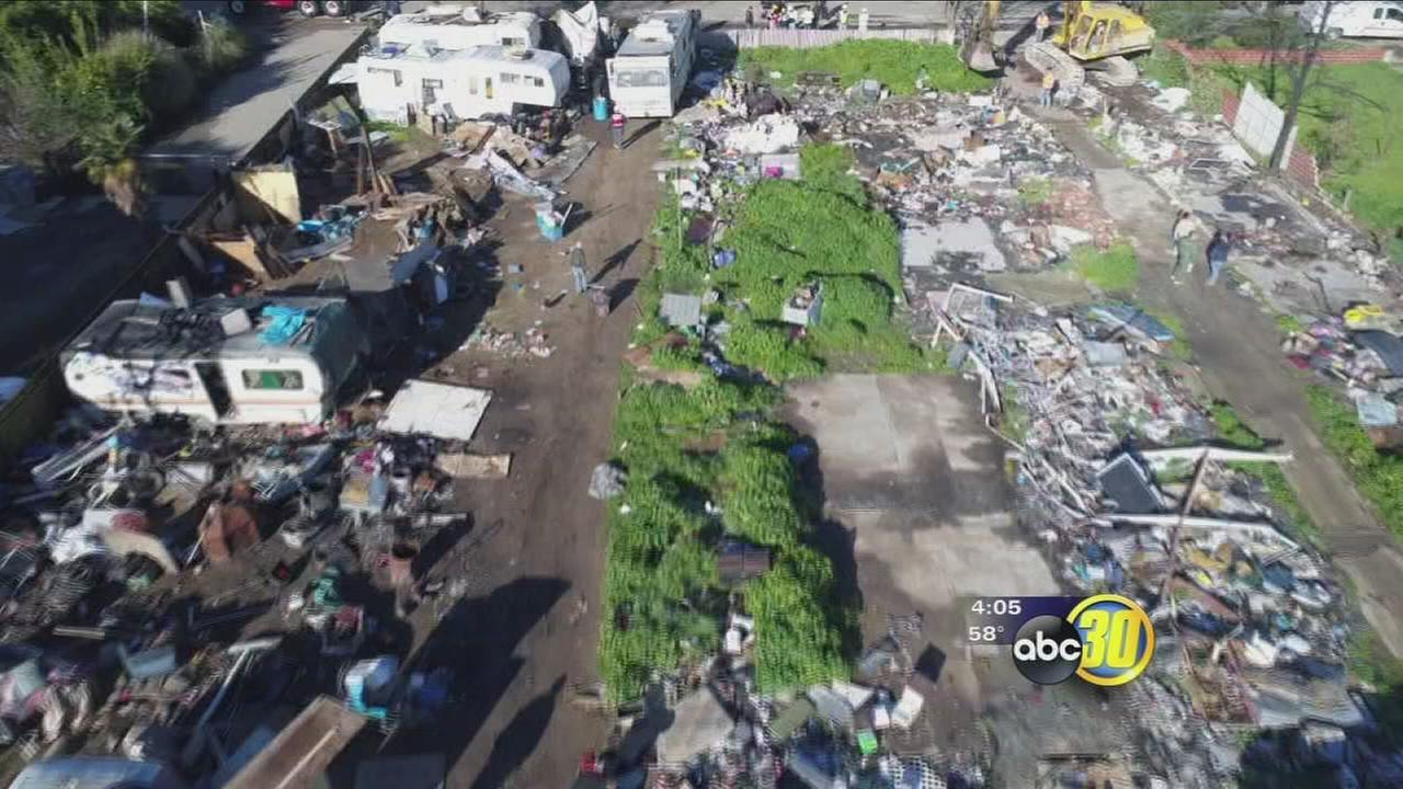 Gas line ruptures while county crews clean up homeless encampment