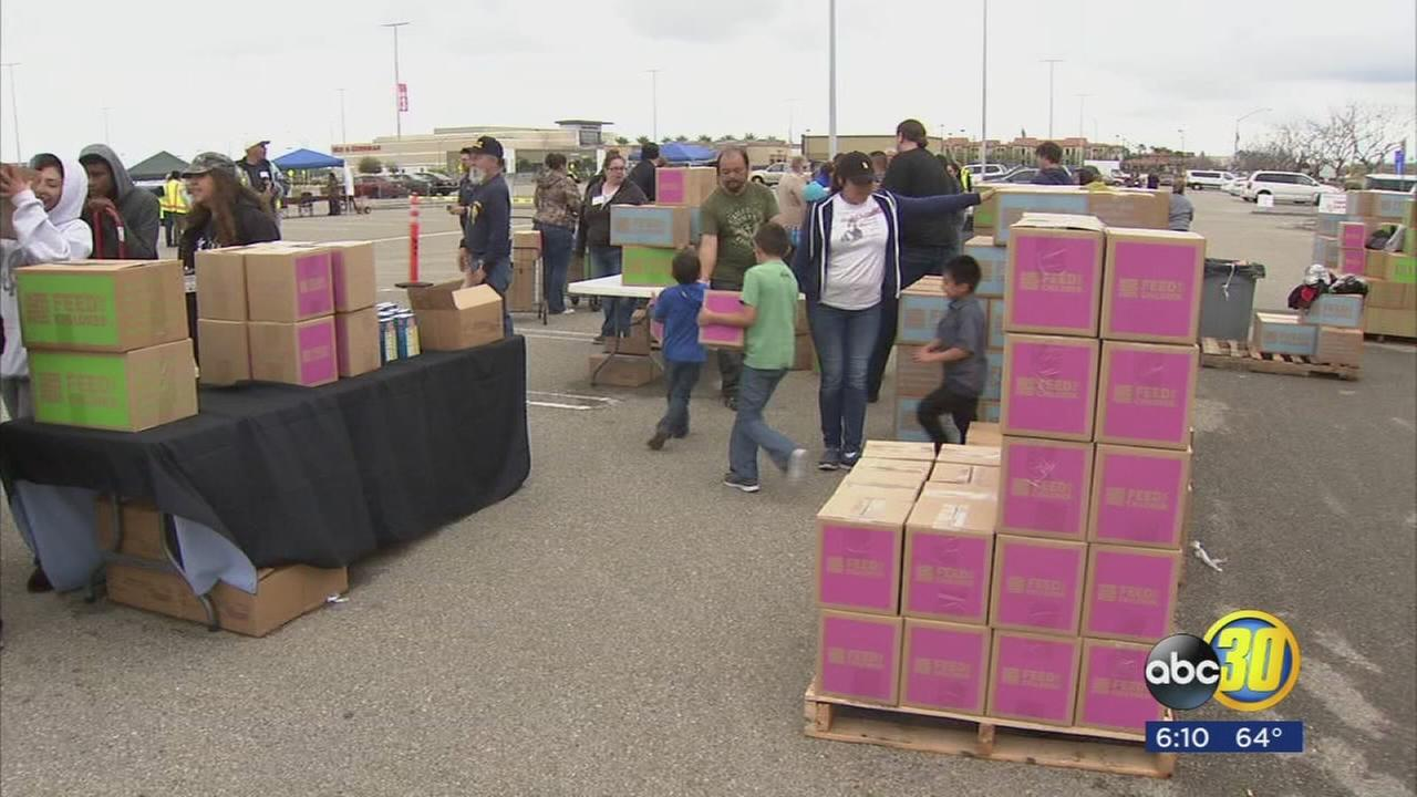 Bull riders deliver food to families in need at Save Mart Center