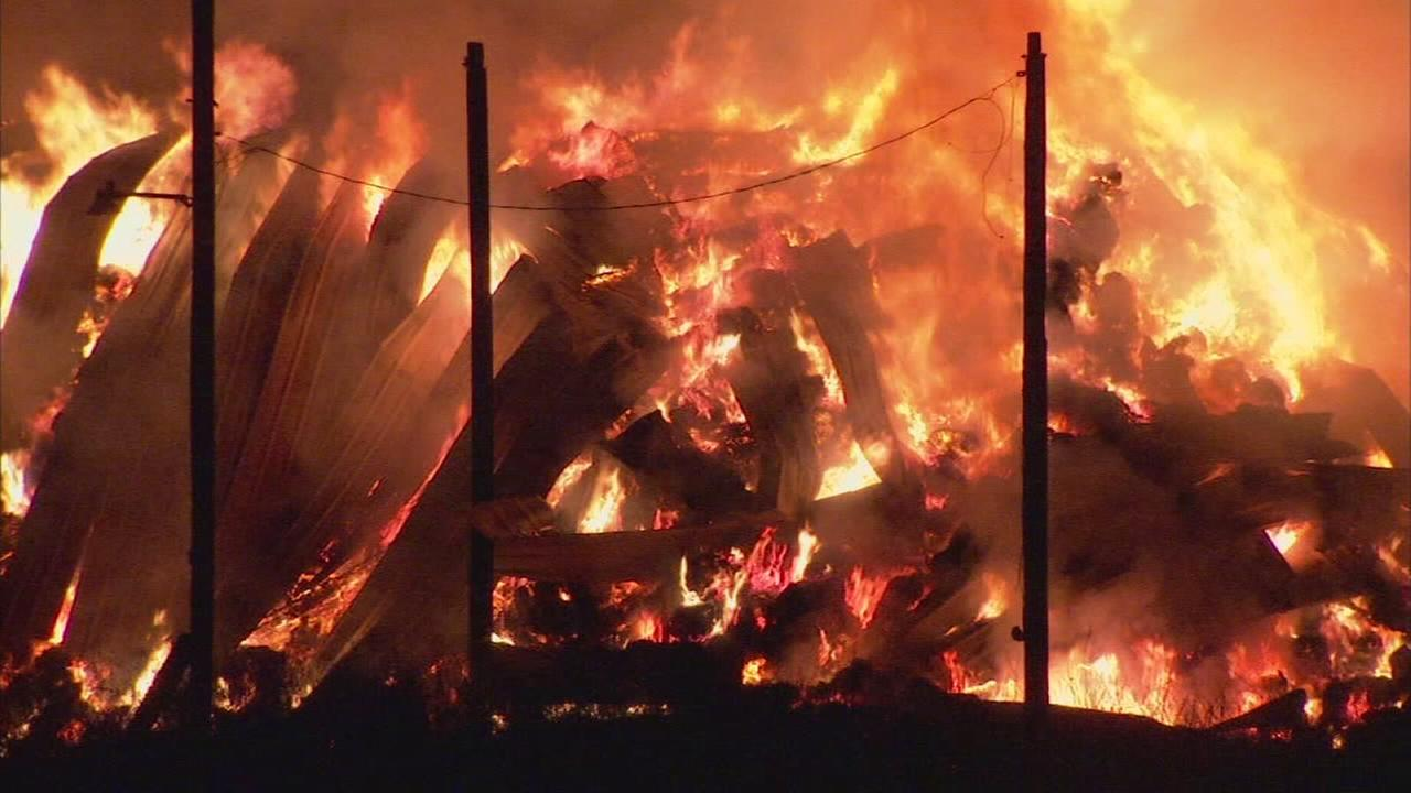 100 tons of hay on fire in Southwest Fresno