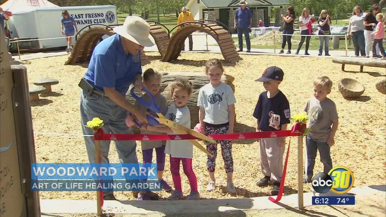 Volunteers complete playground at Woodward Parks Art of Life Healing Garden