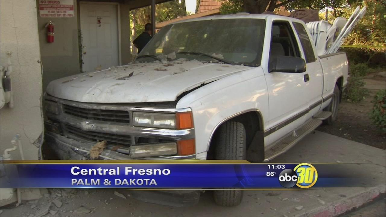 Truck crashes into two apartments in Fresno