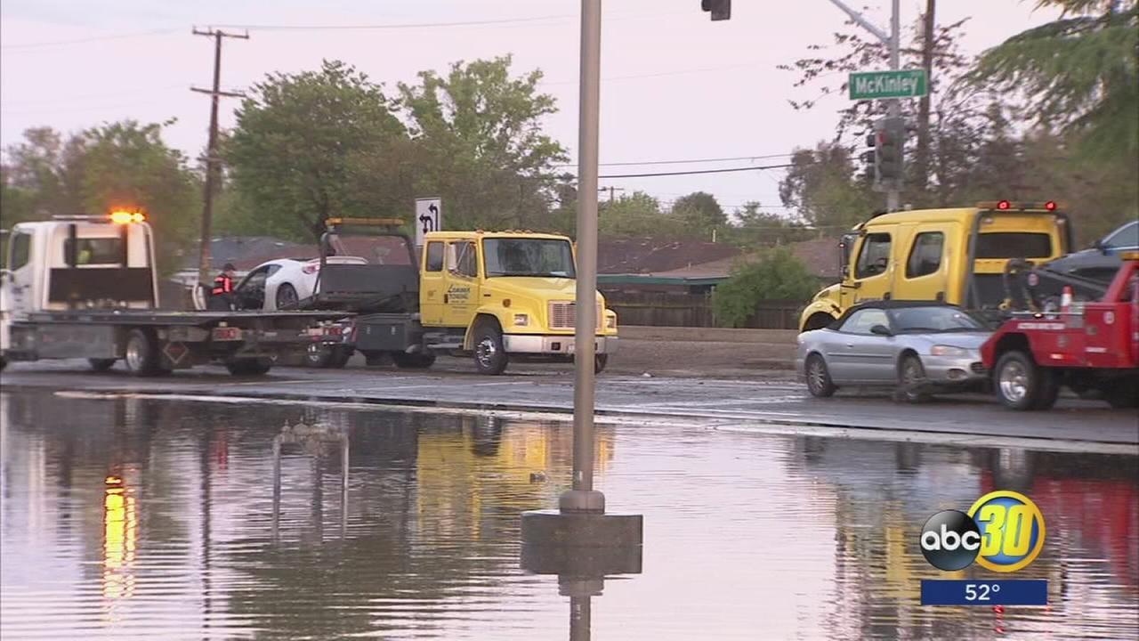 Fresno residents mopping up after heavy rains causes flooding