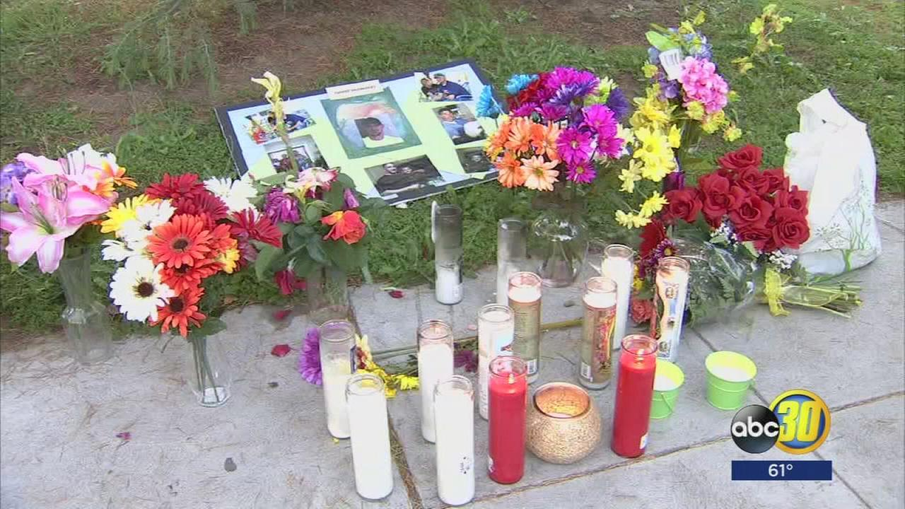 Family and friends gather to honor the memory of one of the victims a shooting spree in Central Fresno