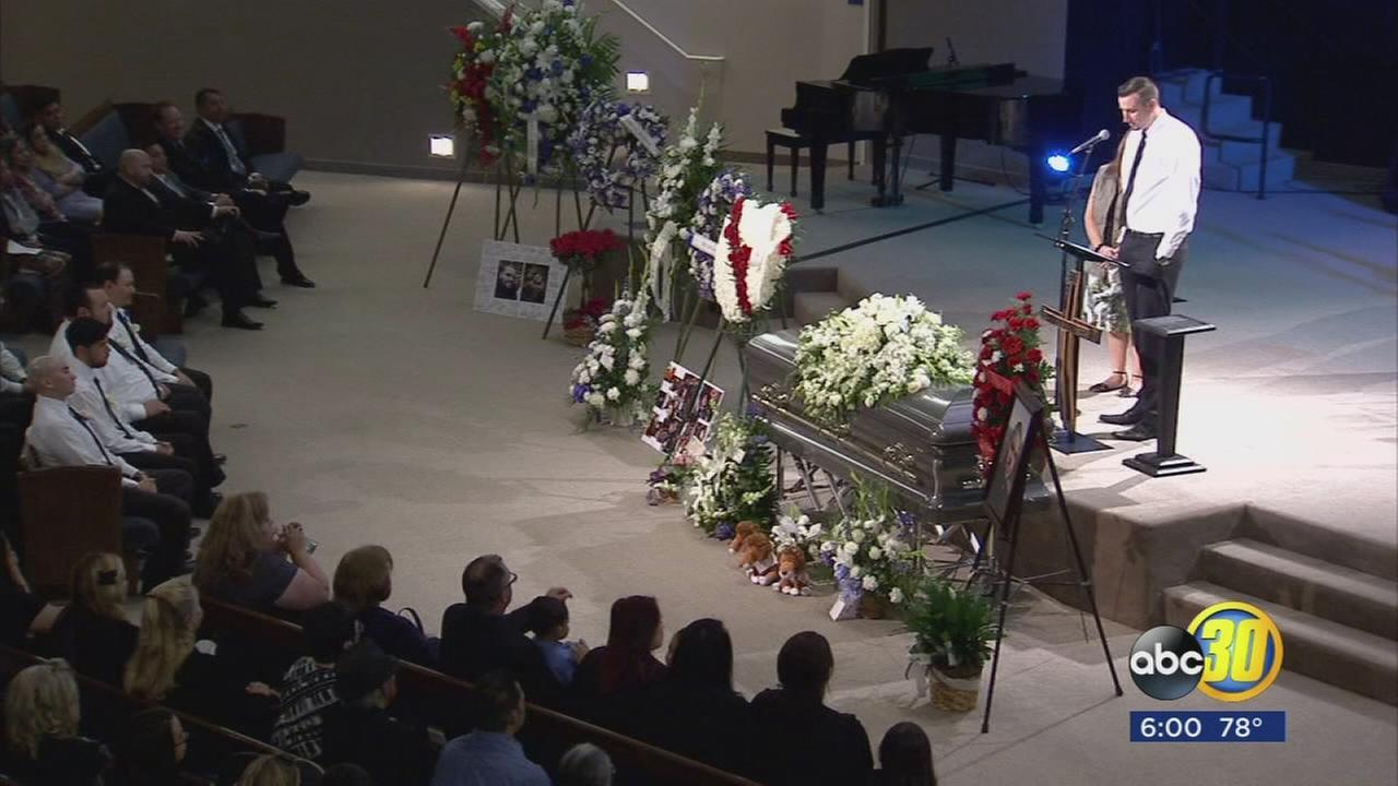 Friends and family say final goodbye to security guard allegedly killed by shooting spree suspect