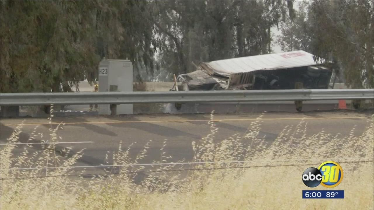 Highway 99 shut down in Madera County after big rig crashes, catches fire