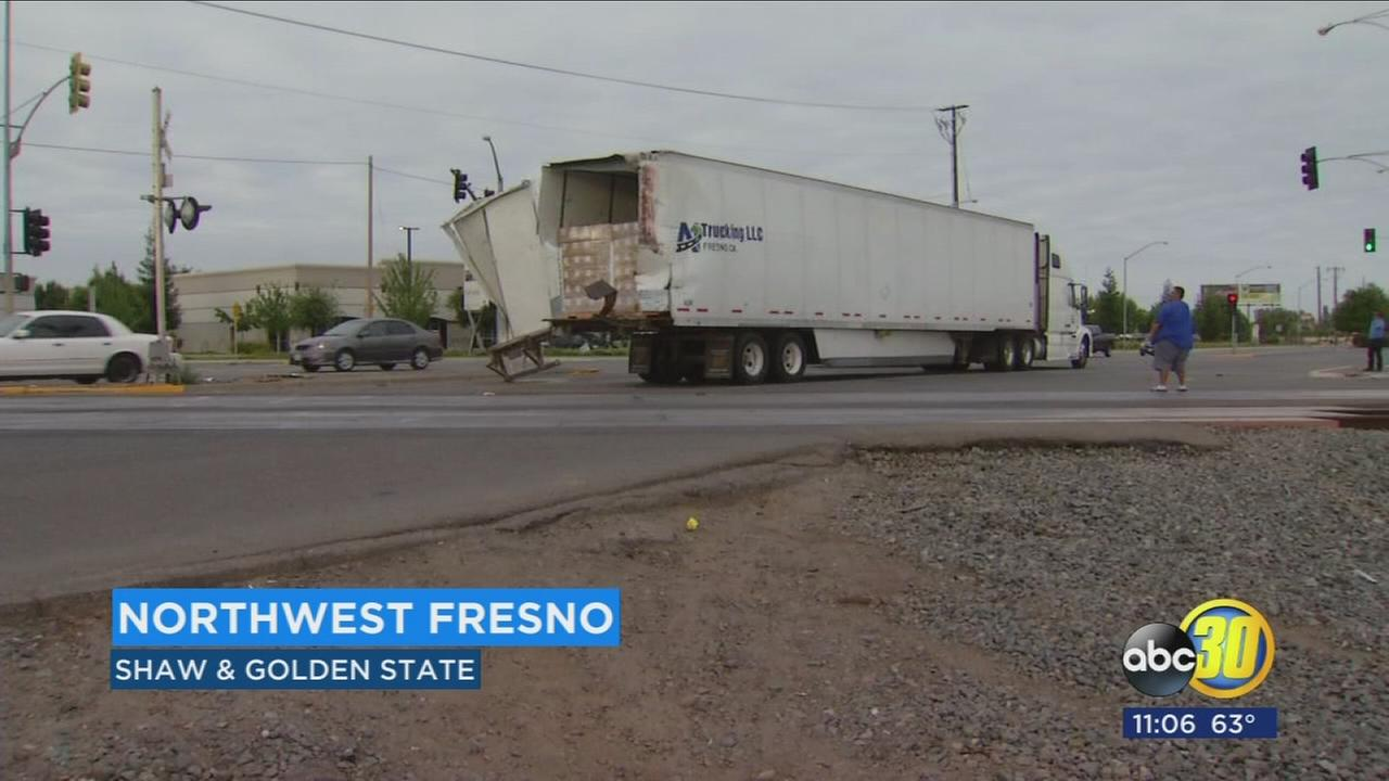 Back of semi-truck sheared off by train in Northwest Fresno