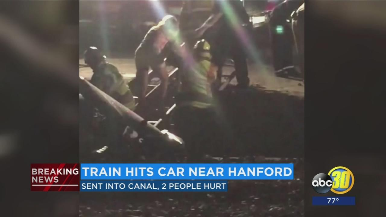 Two people suffer minor injuries after their car is hit by a train in Kings County