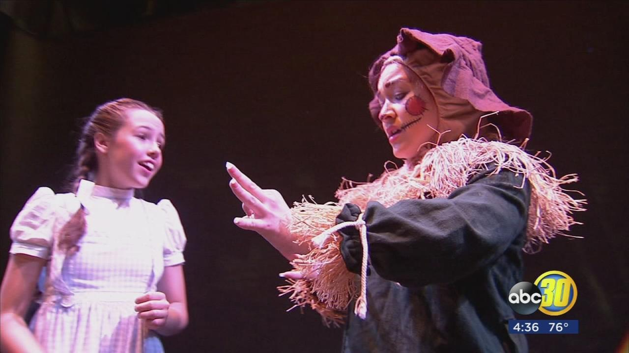 Young actors using sign language in a new production of The Wizard of Oz