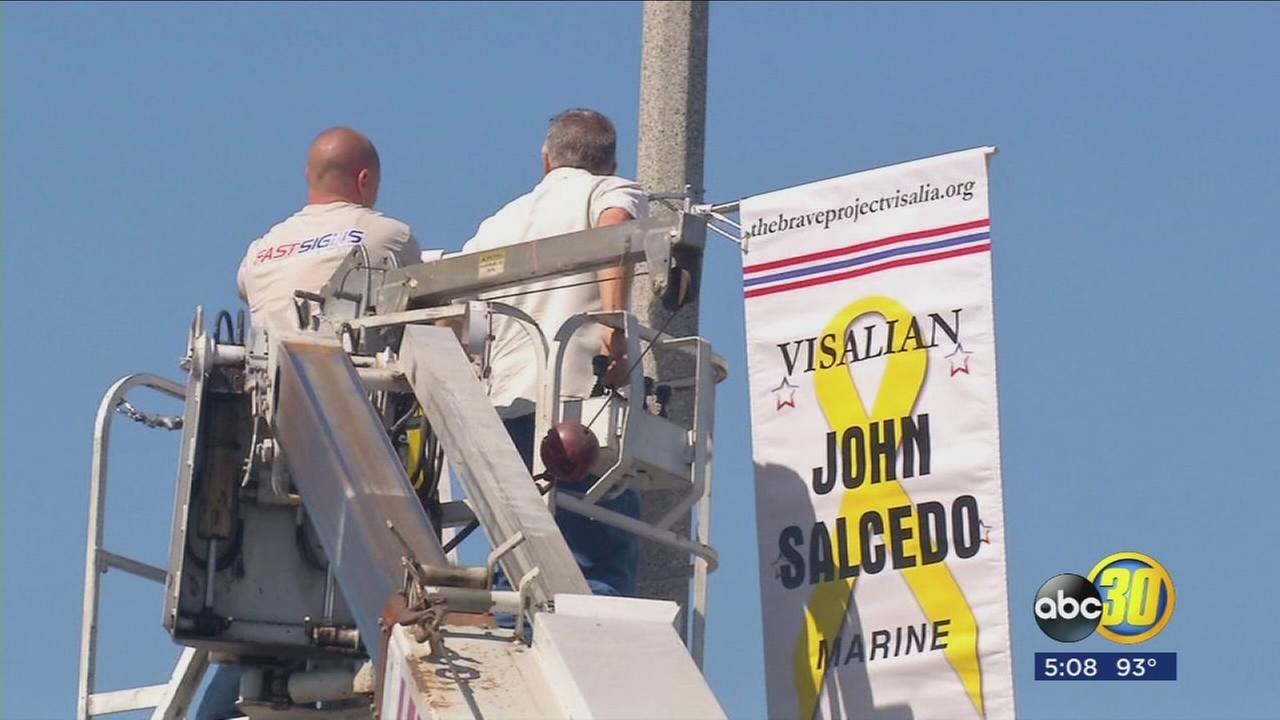 Visalia group honors veterans and service members by installing nine new banners