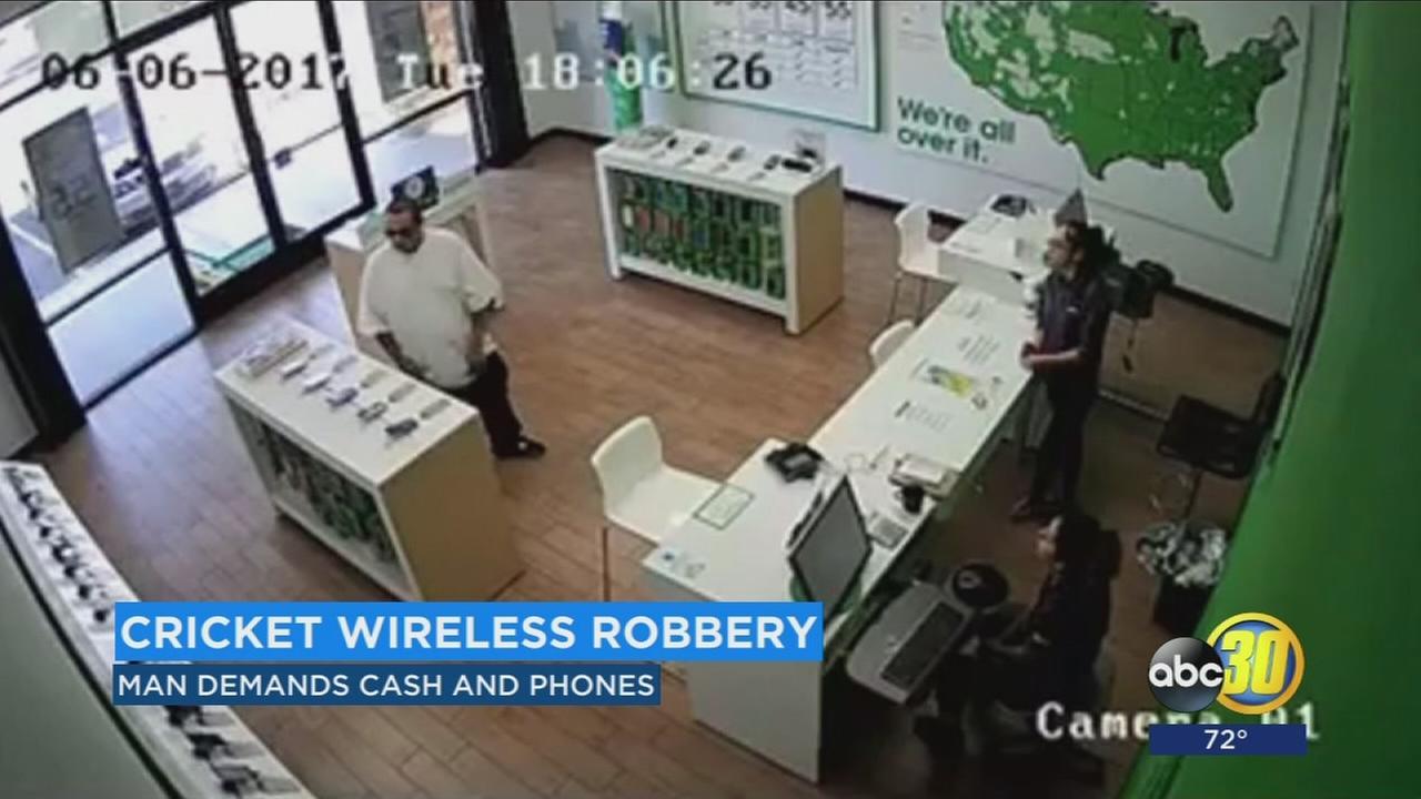 Surveillance video shows man robbing Cricket Wireless store in Madera