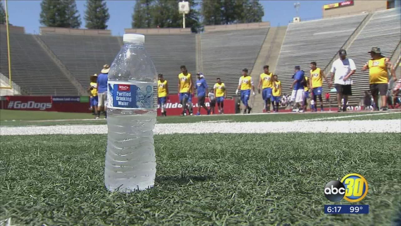 Athletes continue training at Fresno State despite heat