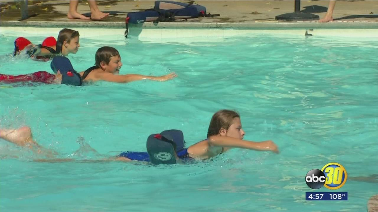 Camp at a Fresno County water park helping kids keep cool and teaching them how to save lives