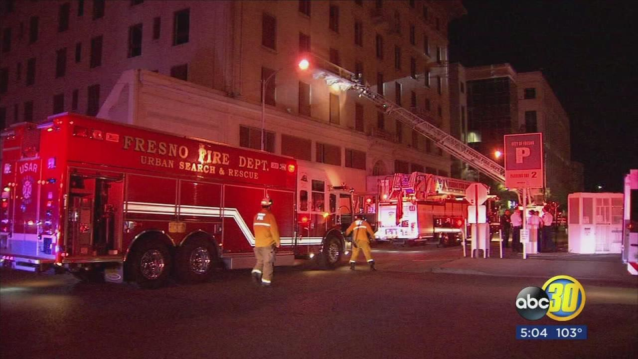 Woman survives four story fall from Hotel Fresno
