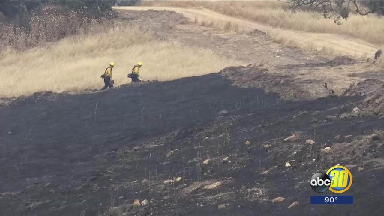 Firefighters spread thin across California as crews battle massive wildfires