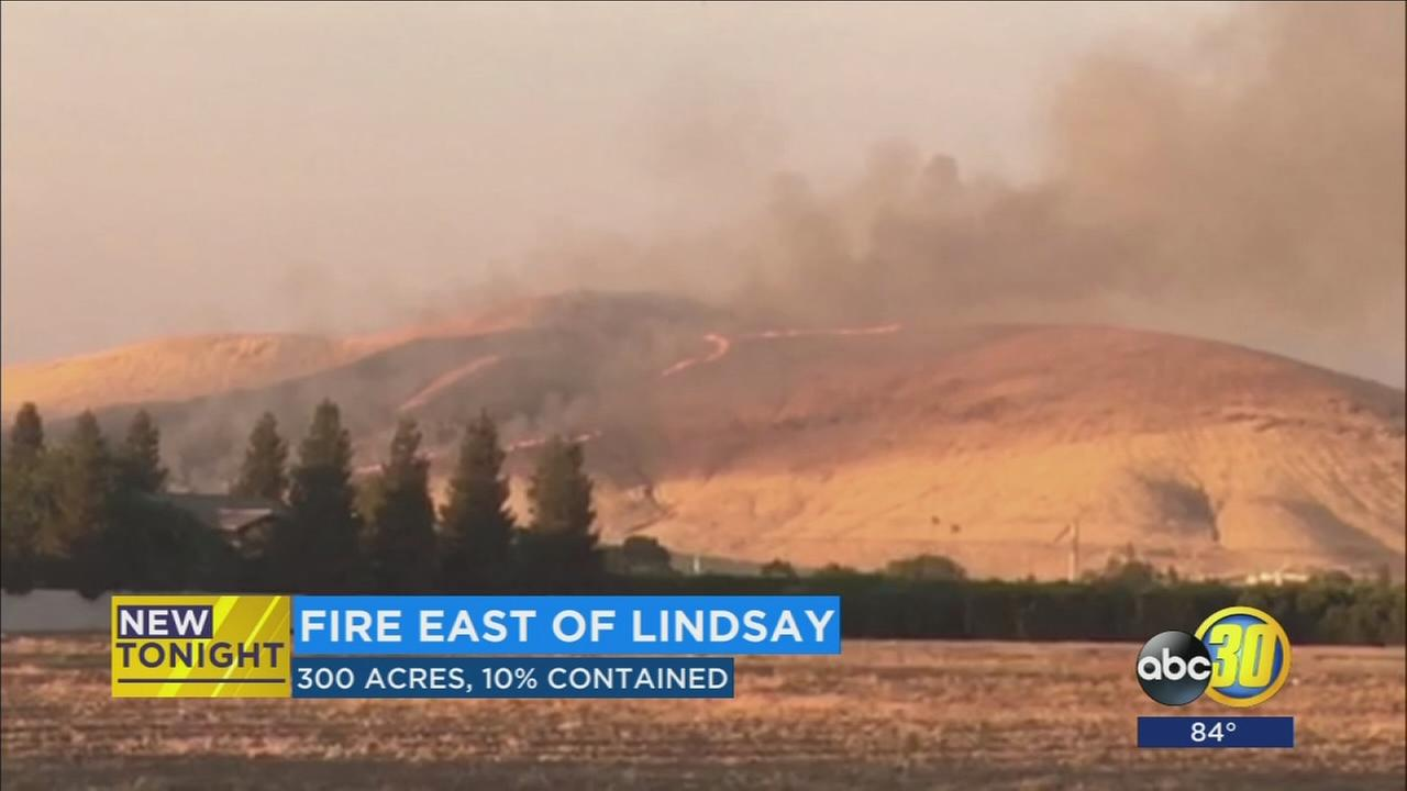 Cal Fire battling grass fire east of Lindsay