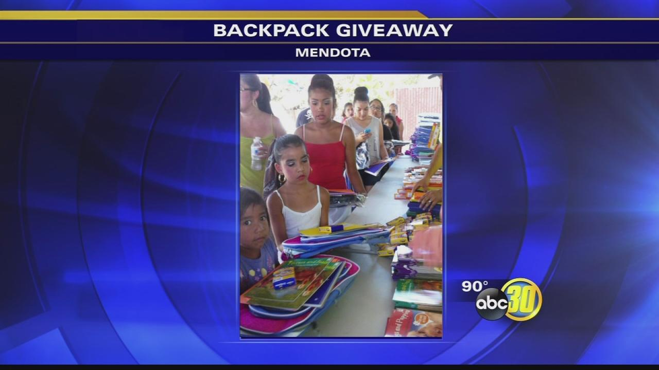 Mendota business owner holds 14th backpack giveaway for kids