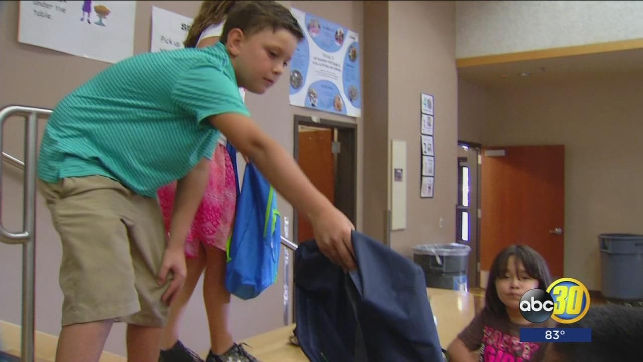 4th grader in Fresno gives backpacks and supplies to school kids
