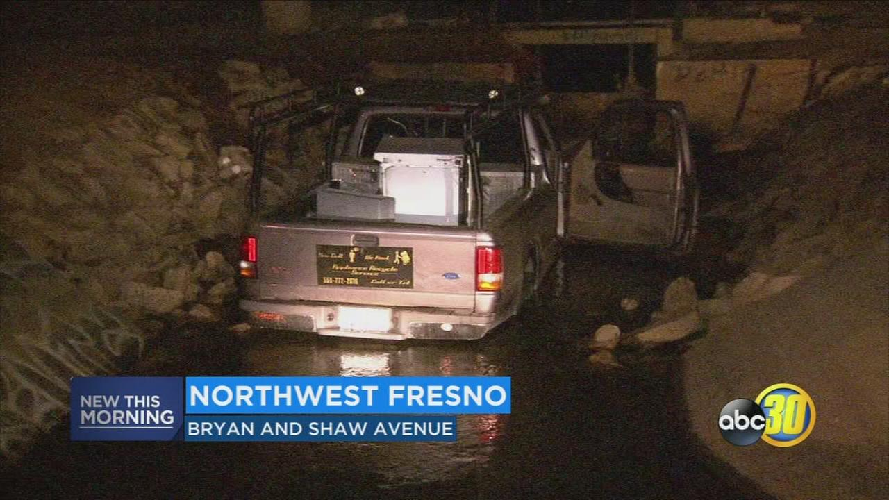 Suspected DUI driver crashes into Northwest Fresno canal