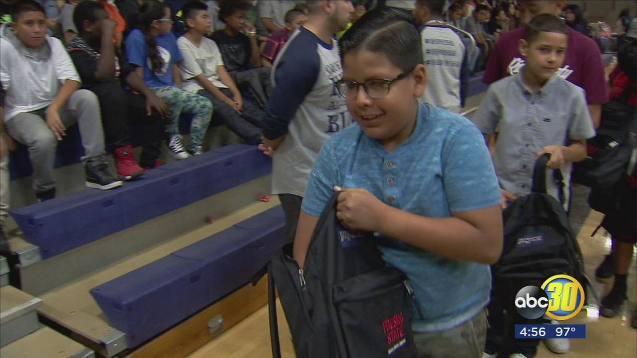 Fresno State partners with United Way to deliver hundreds of backpacks to Madera students