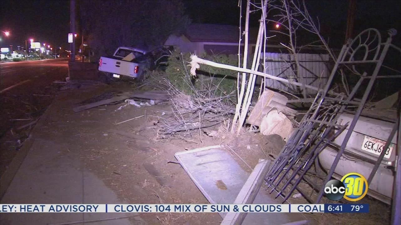 Hit and run driver causes damages two fences, power pole, in Central Fresno