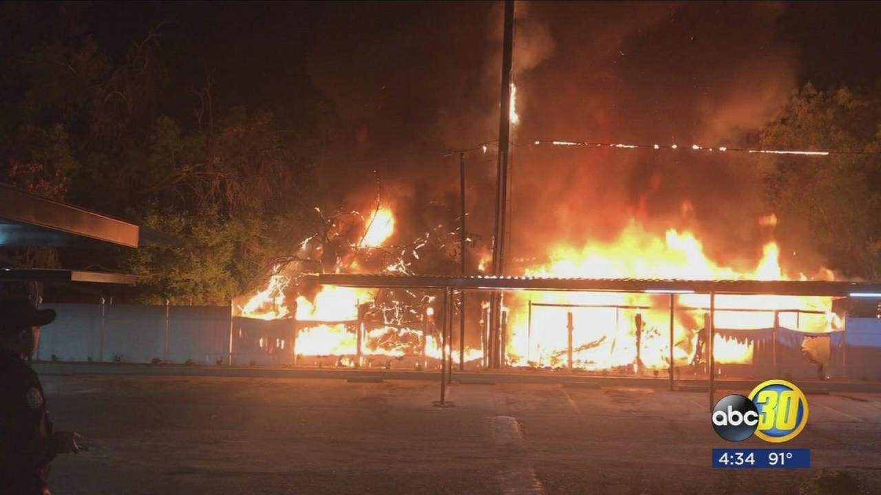 Huge flames erupted overnight in Southeast Fresno, neighbor jumps into action to save home