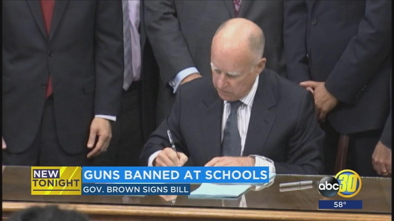 Gov. Brown signs new bill banning all guns on school campuses