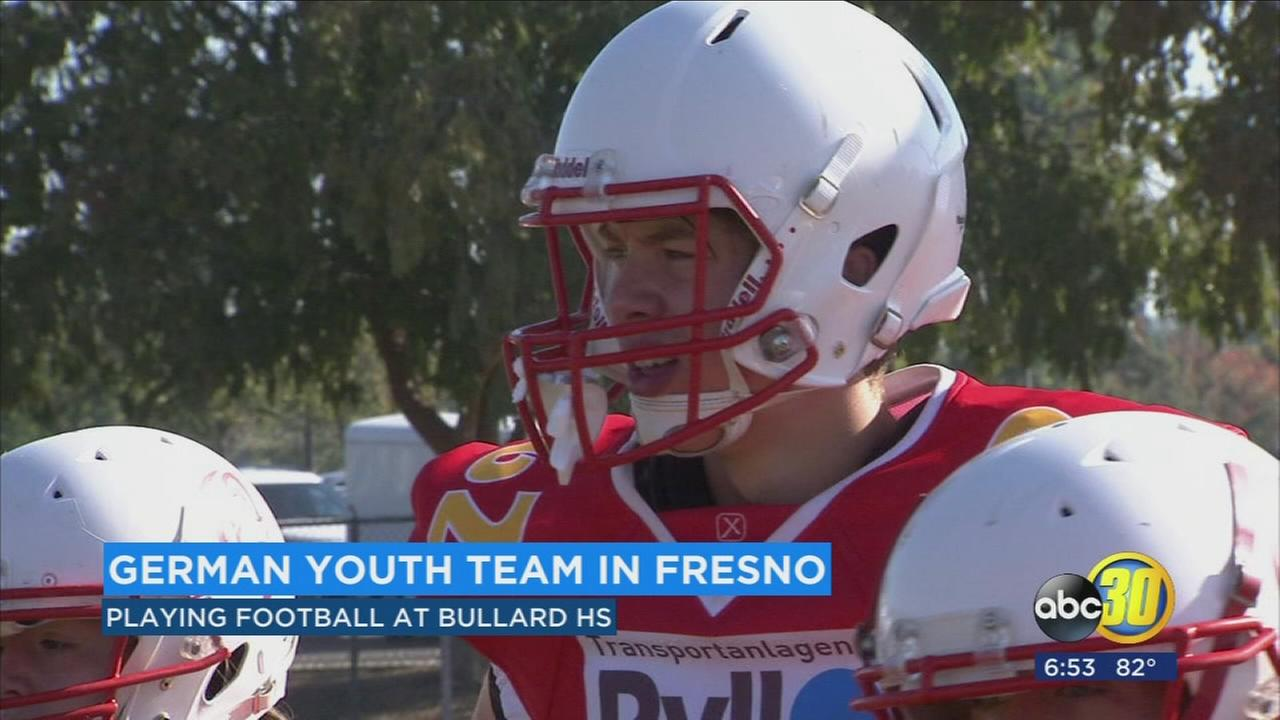 German teenagers learning the game of football from Fresno coaches