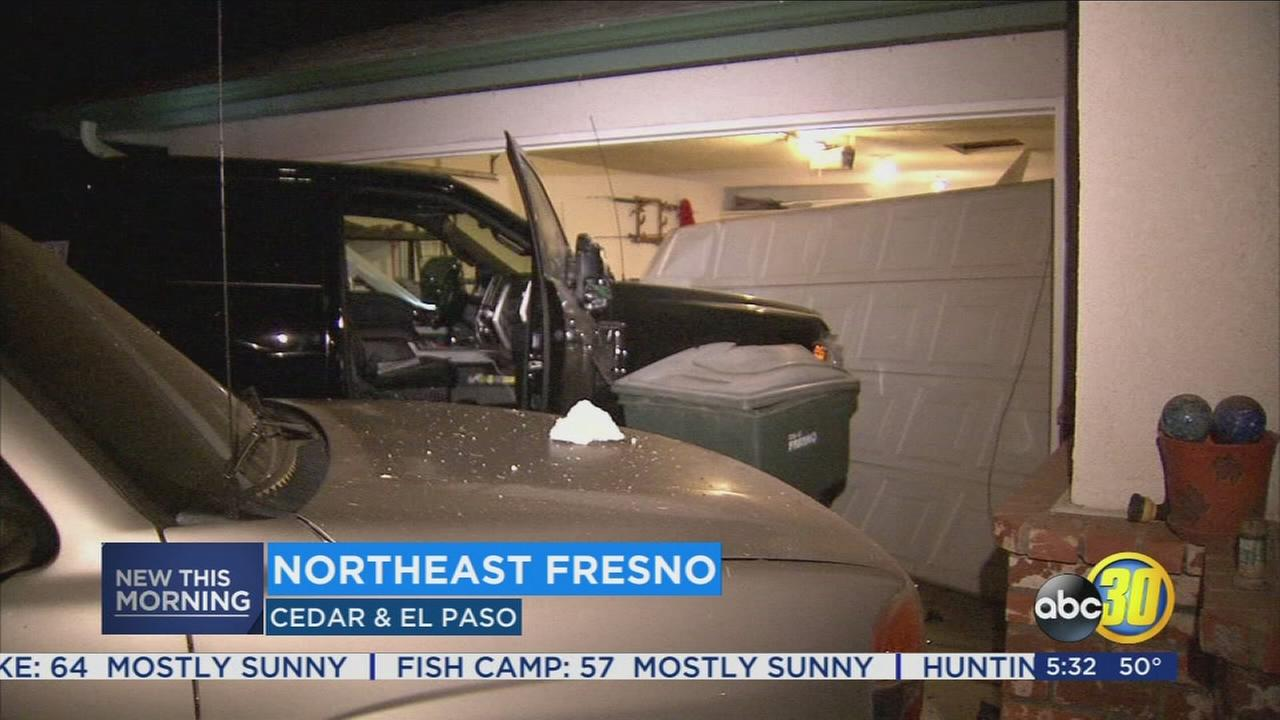 Police search for driver who crashed into Northeast Fresno home