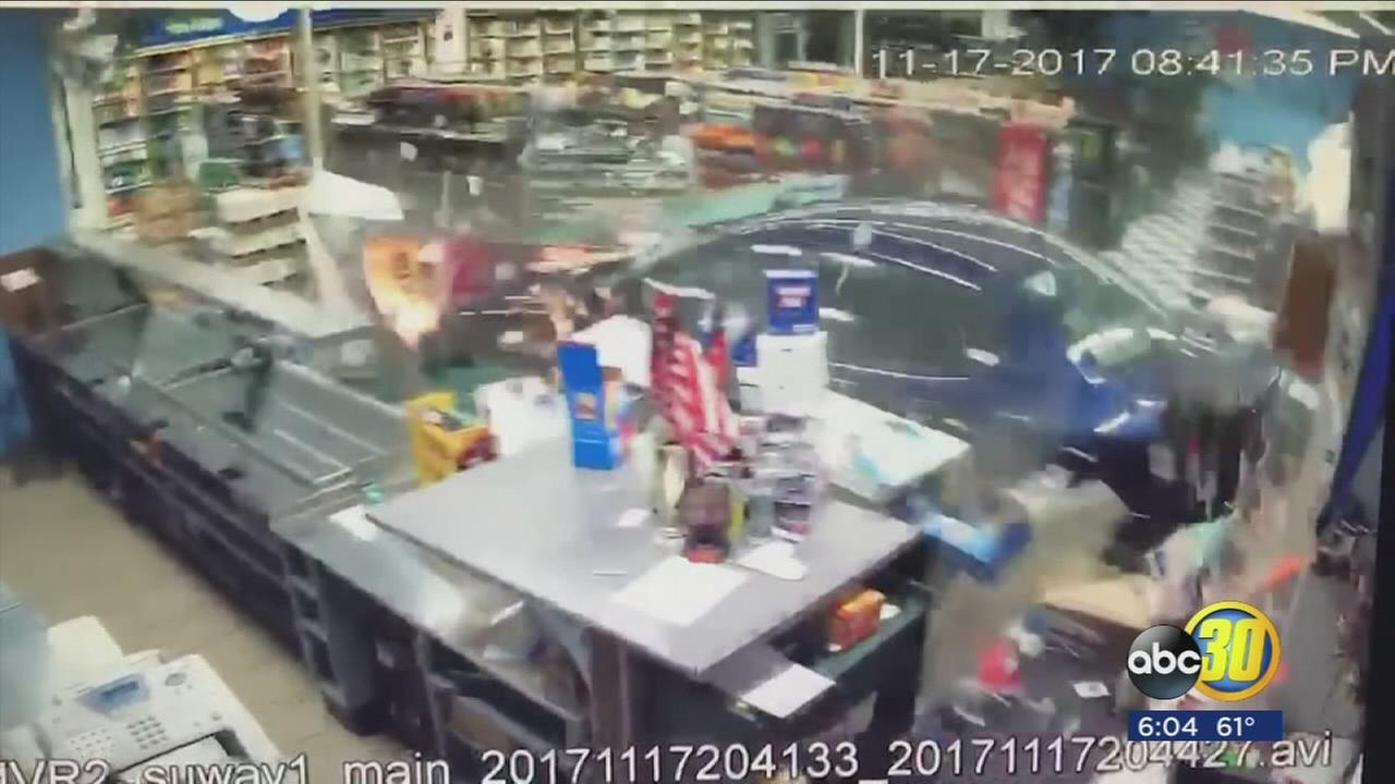 Car slams into store