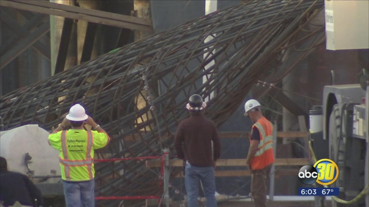 Two people are trapped under collapsed structure in Northwest Fresno