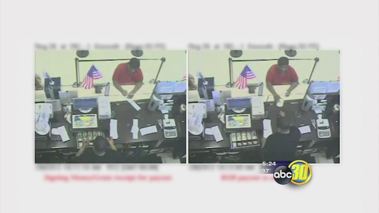 Surveillance camera photos help catch scam artist