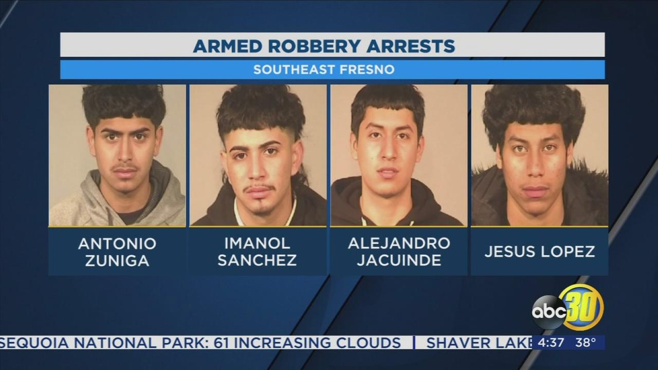 4 men and teen in custody after robbing student at gunpoint