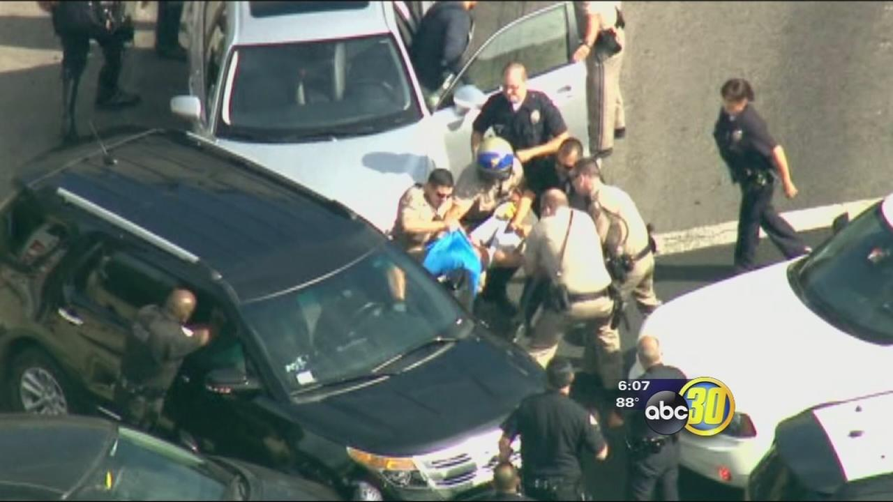 Suspect yanked from SUV after high-speed chase