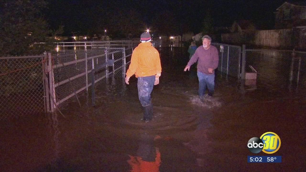 Properties flooded after canal spills over in Fresno County
