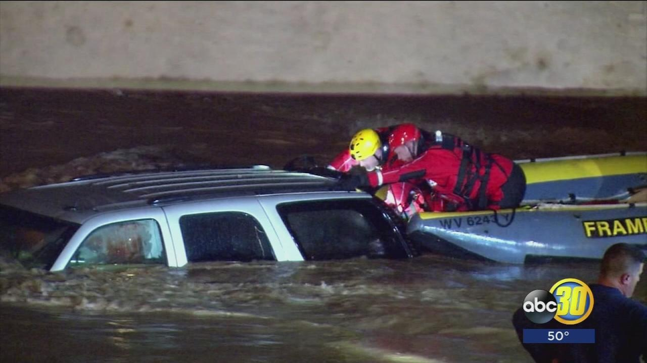Man rescued from SUV as flood waters continue to rise in West Virginia
