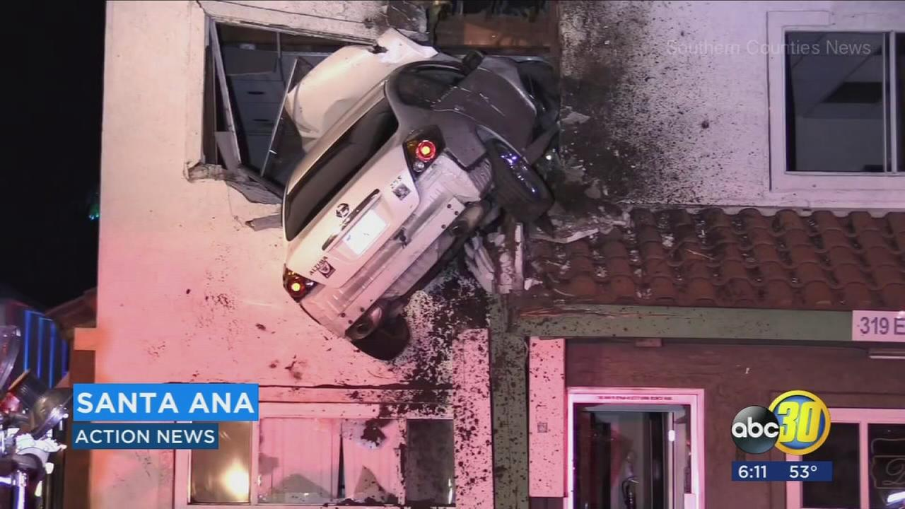 Car soars into second floor of Santa Ana building in bizarre crash; 2 hurt