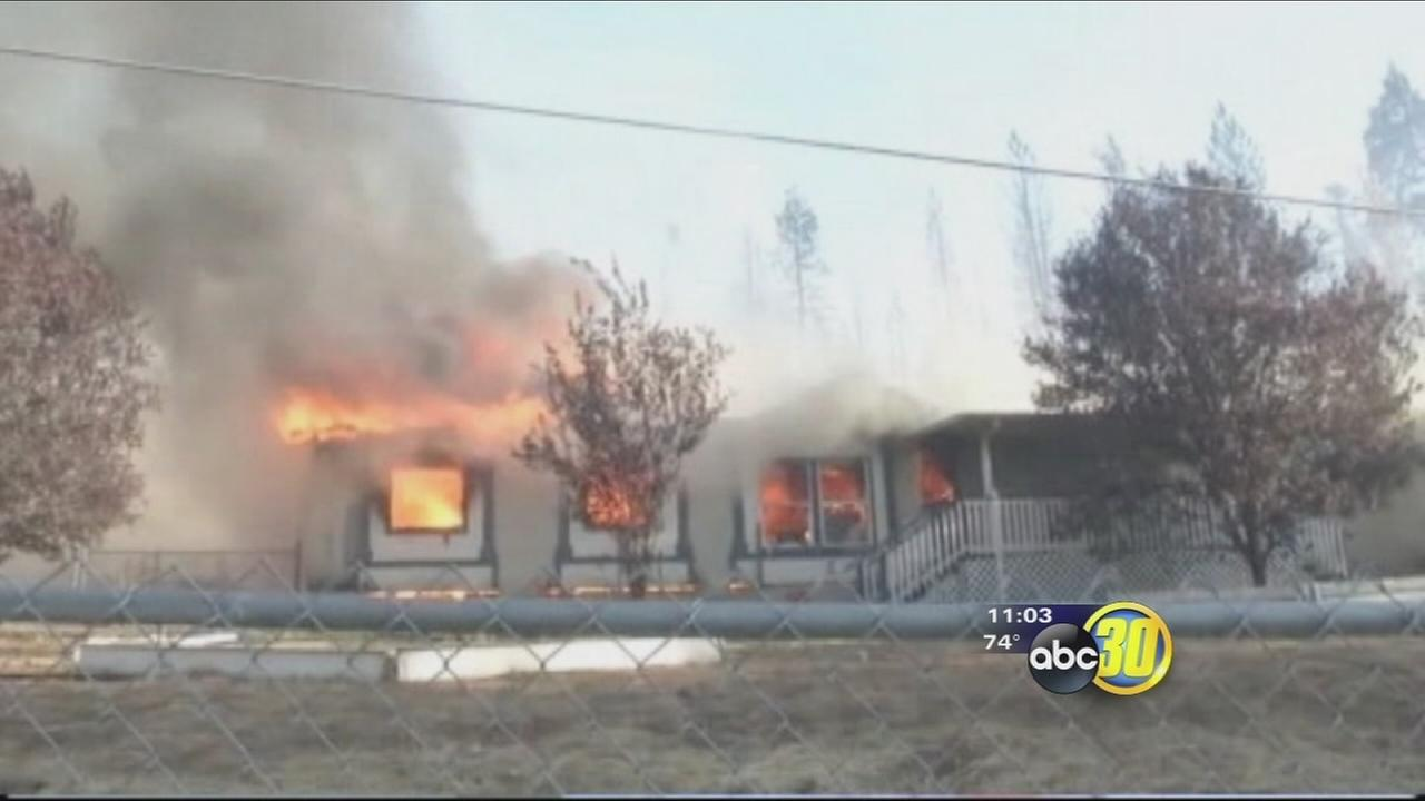 Racing wildfire engulfs homes in Weed, California